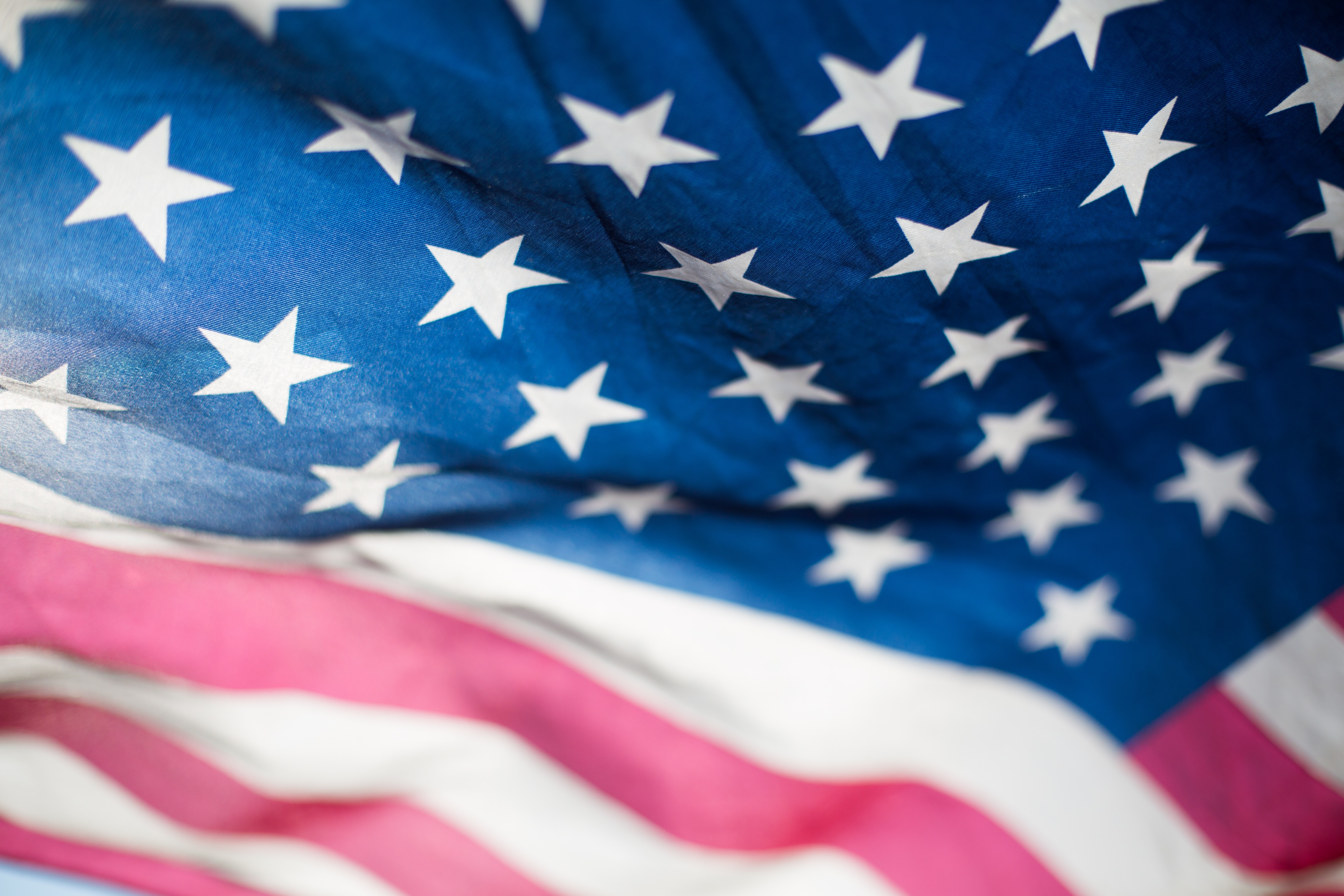 Closeup of stars and strips of waving United States flag