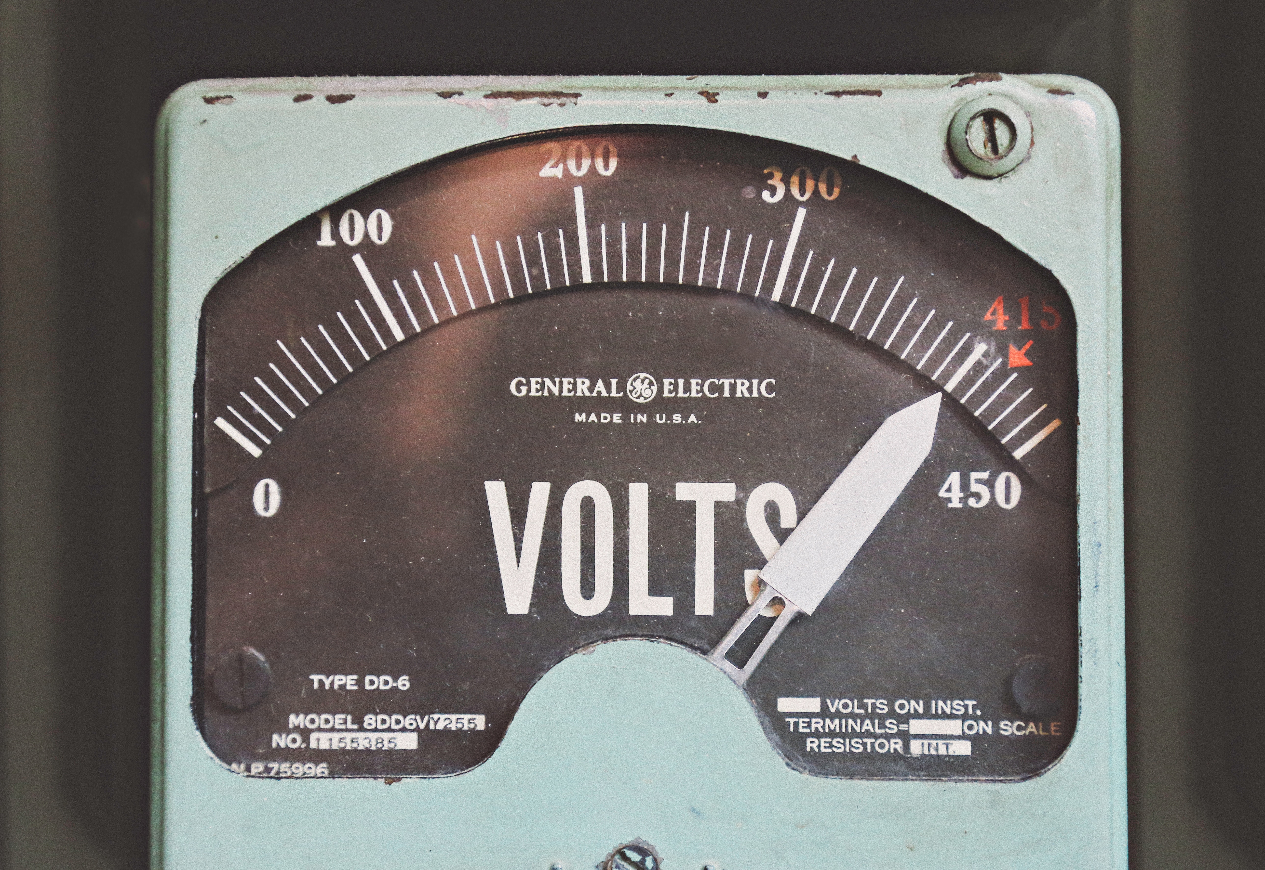 An old GE voltage meter displaying a high voltage reading