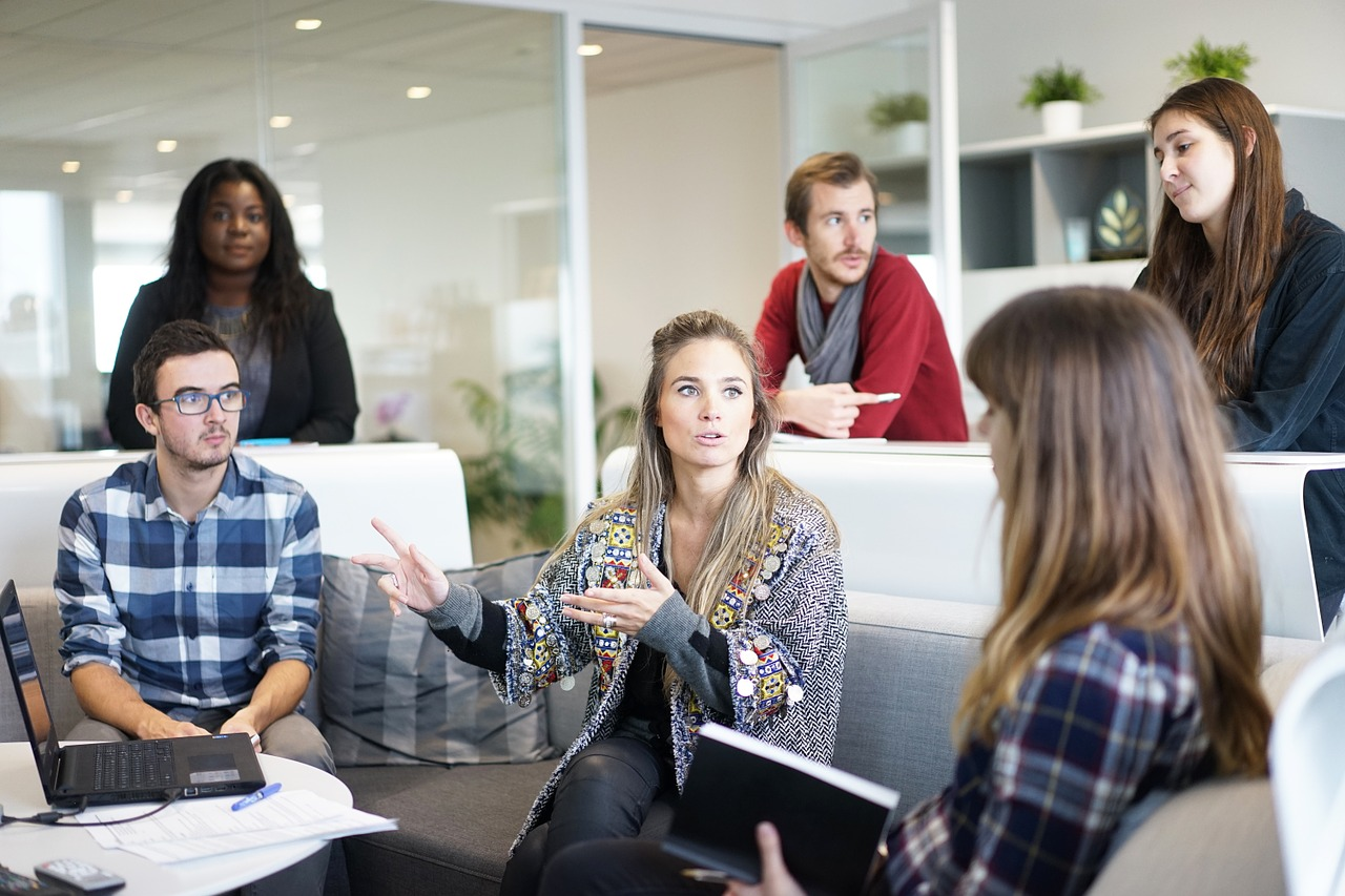 Six people sitting in casual work environment having an informal discussion